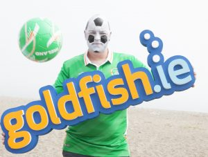 NO REPRO FEE Team rivalries were temporarily put aside as Gordon O'Neill CEO (Ireland), and Simon Palmer Marketing Manager (England), of cloud telecoms firm Goldfish.ie donned their team's national colours and had their heads painstakingly painted as footballs, to launch the Green Glory Euro 2016 competition on Greystones Beach.