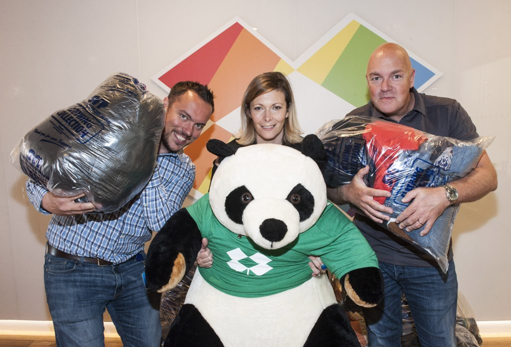 Pieter Jannssens, Dropbox's Head of Mid-Market Sales, Central and Northern Europe with Nichola Mullen, Head of Fundraising for St Vincent de Paul and Gordon O'Neill, found and CEO of telecoms firm Goldfish.ie and Dropbox's mascot 'Panda'  in Dropbox's European Headquarters in Dublin for the launch of the 'Sack The Suit' charity campaign, in aid of The Society of St Vincent de Paul. Pic Patrick O'Leary No Repro Fee.