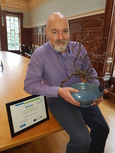 Golfish's CEO Gordon O'Neill with his beautiful 'trophy' by Wicklow artist Magda Bethani